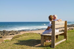 HDT couple on bench at the beach